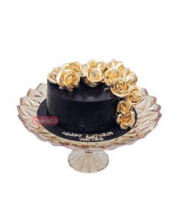 Black cake with golden flower